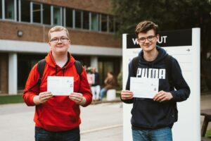 Two students celebrate their GCSE results